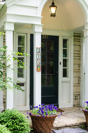 "Example of ""315"" Sincerely, Sticks house number plaques displayed vertically at a front door"