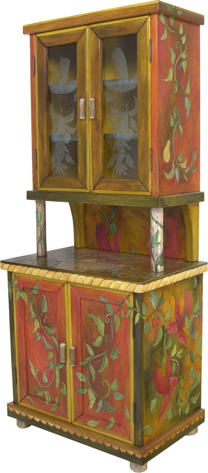 China Hutch –  Fruit vines and birds float around this china cabinet