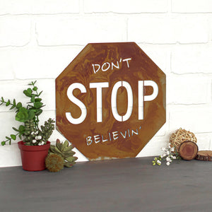 "Don't Stop Believin' Wall Plaque – Inspired by graffiti'd stop signs everywhere, Prairie Dance created this metal wall hanging with the lyrics from Journey's song ""Don't Stop Believin'"" for a little motivational artwork"