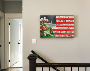 Sincerely, Sticks printed stretched canvas wall art with flag and mountain motif, staged on a home's wall above staircase
