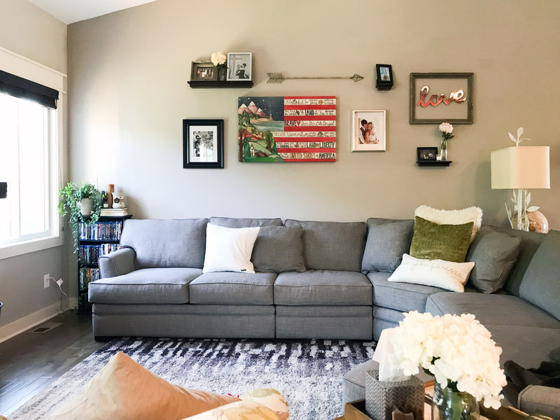 Sincerely, Sticks printed stretched canvas wall art with flag and mountain motif, staged on a home's gallery wall