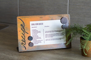 "Long Recipe Card Holder - ""Recipe"" is laser cut through metal on the side of this magnetic recipe holder which keeps recipes up of the counter and away from spills and makes a great house warming or wedding gift"