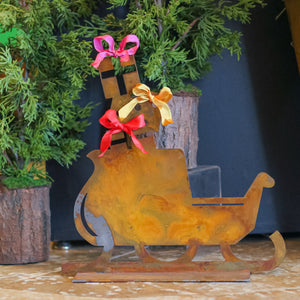 Santa's Sleigh Sculpture – Presents stacked in the back of Santa's sleigh, this sculpture would make a great holiday vignette with Dancer and Blitzen main view