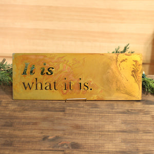 "It Is What It Is Wall Plaque – This sweetly simple metal sign that reads ""It is what it is"" reminds us we can't always control what it happening around us but we can move forward and what will be, will be"