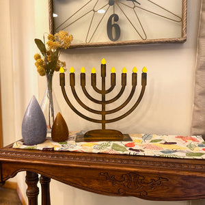 Menorah Sculpture – Dress up your home's dining table or mantle during Hanukkah with this menorah that includes little yellow candle magnets main view