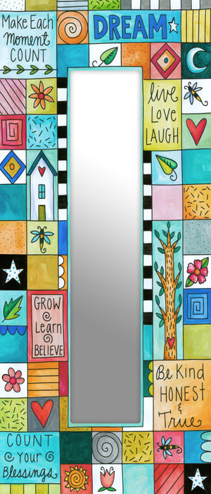 """Playful Patchwork"" Mirror – Colorful patchwork design intermixing sweet phrases and cute boxed icons front view"