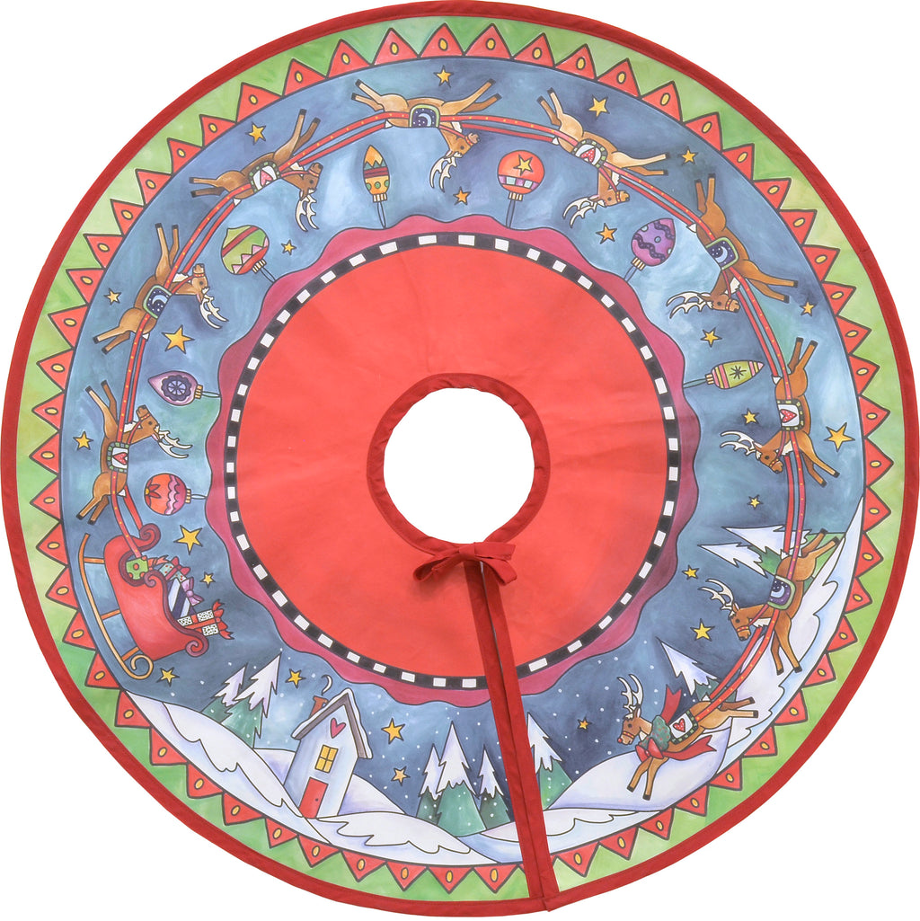 Rudolph and his reindeer crew circle around a starry-sky landscape on our canvas tree skirt