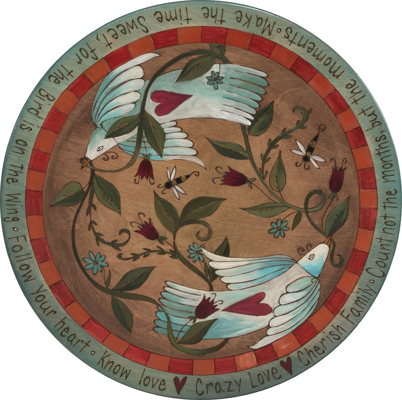 "Sticks Handmade 20""D lazy susan with two love and peace birds with flowering vines"