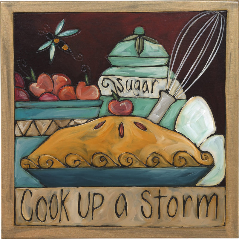 "Sticks handmade wall plaque with ""Cook up a Storm"" quote and dessert themed imagery"