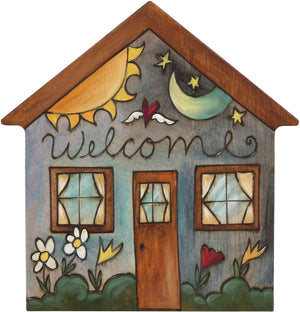 "House Shaped Plaque –  ""Welcome"" house shaped plaque with sun and moon motif"