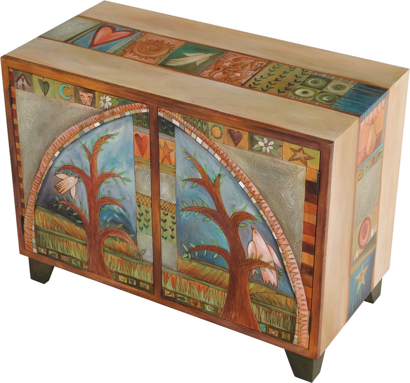 Media Buffet –  Elegant and neutral media cabinet with tree of life motifs and colorful block icons throughout