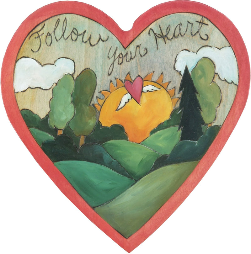 "Heart Shaped Plaque –  ""Follow Your Heart"" heart shaped plaque with rising sun landscape and heart with wings"