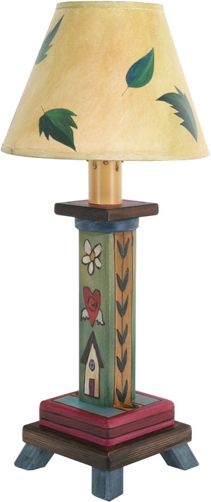 Milled Candlestick Lamp –  Lamp with a leafy shade design and stacked Sticks icons fill the base