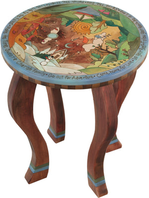 Round End Table –  Playful four seasons end table with colorfully painted scenery
