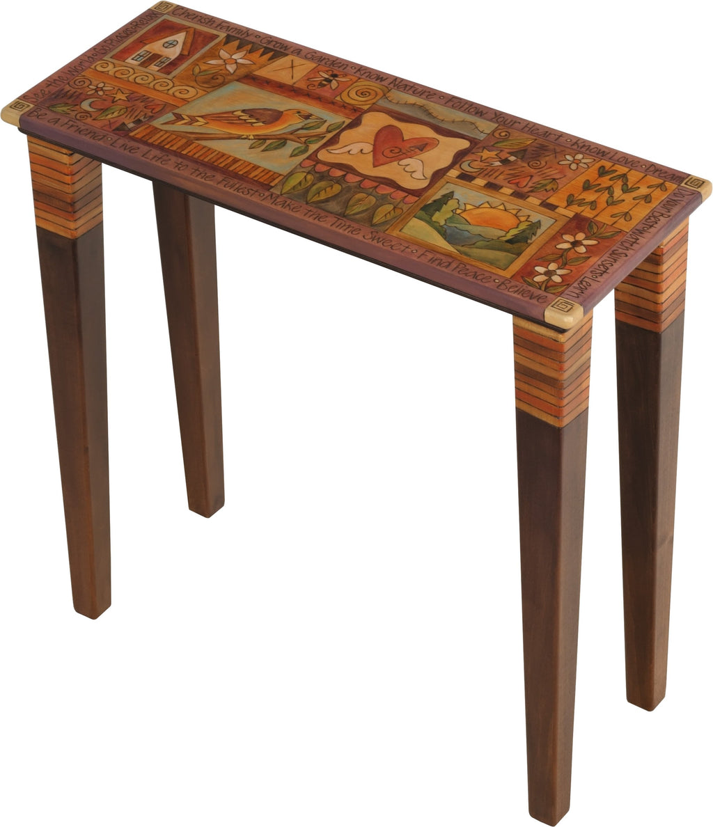 Sticks handmade console table with colorful life icons in neutral palette