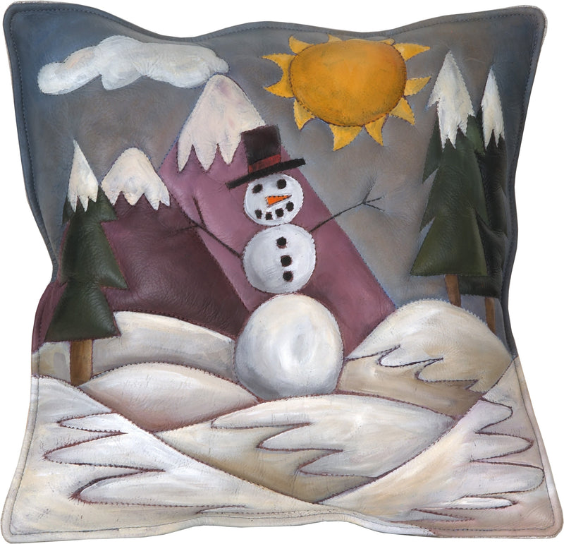 Leather Pillow –  Holiday pillow with snowman in a winter scene, mountains and a sunny sky