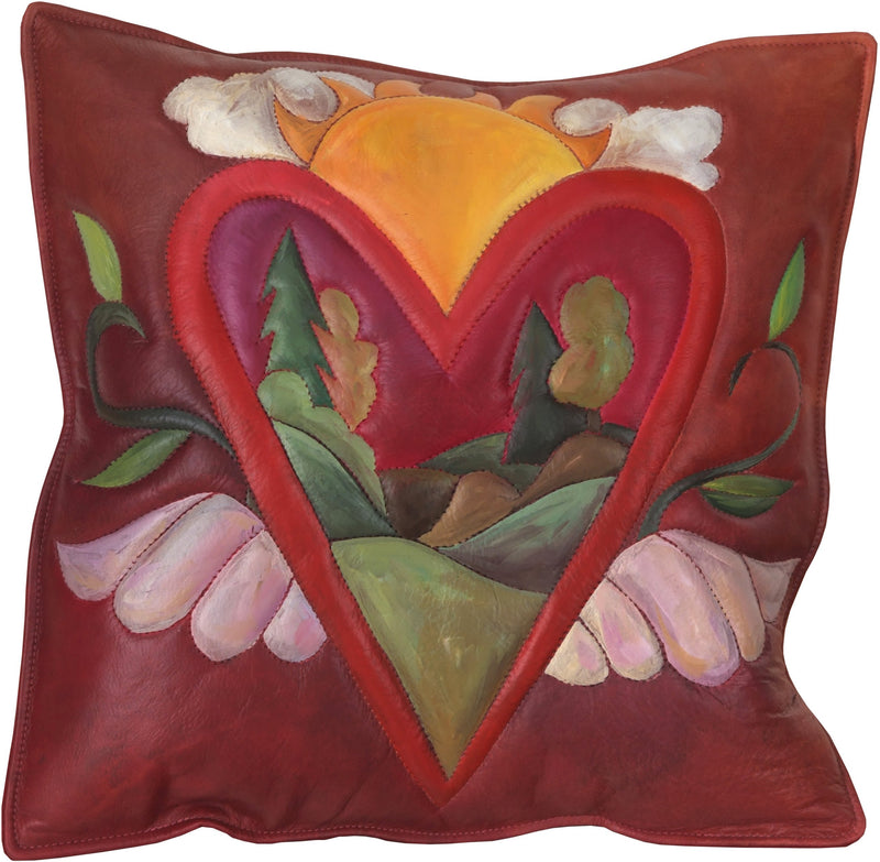 Leather Pillow –  Heart with wings pillow framing a rolling landscape
