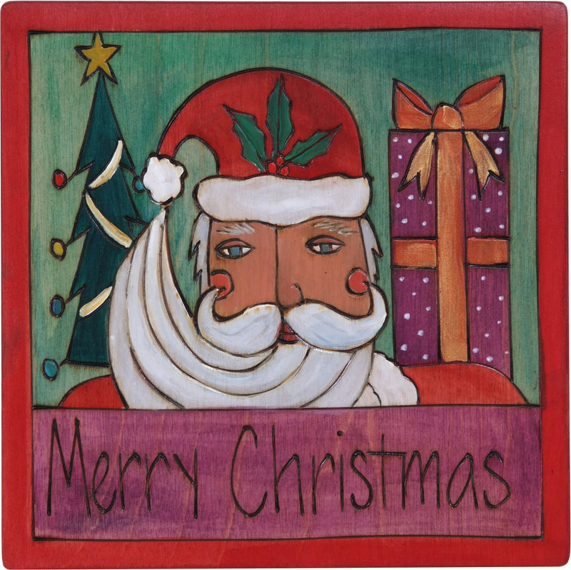 "7""x7"" Plaque –  ""Merry Christmas"" holiday plaque with Santa, Christmas tree and a big gift"