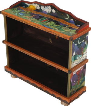 "Short Bookcase –  ""Go Out for Adventure/Come Home for Love"" bookcase with sun and moon over snow-capped mountains motif"