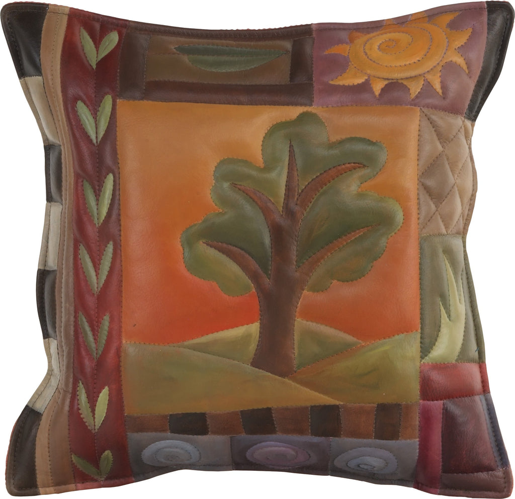 Leather Pillow –  Hand painted pillow in warm hues with a tree at the center