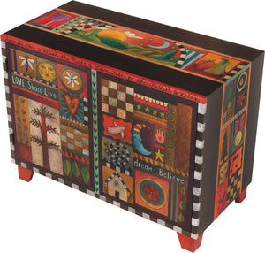 Media Buffet –  Rich folk art media cabinet with many colorful block icons and landscapes