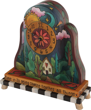 Mantel Clock –  Elegant and colorful clock featuring a heart home and sun and moon motif
