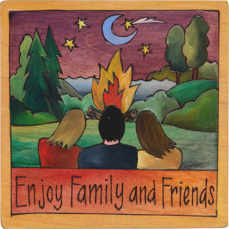 "7""x7"" Plaque –  ""Enjoy family and friends"" huddled around a lakeside bonfire"