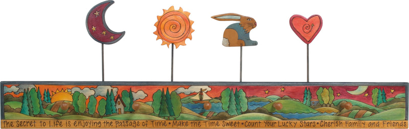Sticks handmade coat rack with colorful rolling landscape and folk art finials