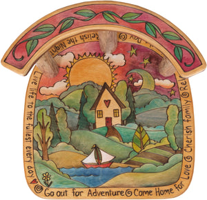 "Stool with Back –  ""Go Out for Adventure/Come Home for Love"" stool with back with sun setting over a cozy cottage nestled in the hills motif"