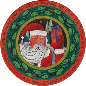 "20"" Holiday Lazy Susan – Santa Claus giving the first gift of Christmas wrapped in a holly vine"