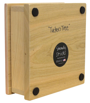 """Tucker's Tree"" Keepsake Box – A Sticks tree of life grows in a hilly landscape back view"