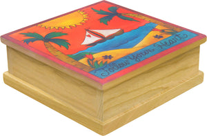 """Wear Your Heart on Your Sail"" Keepsake Box – A boat sails away off a tropical shore main view"