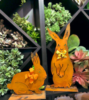 Henry Rabbit Sculpture – Dapper standing rabbit sculpture with a bowtie to celebrate spring season and Easter displayed in front of greenery