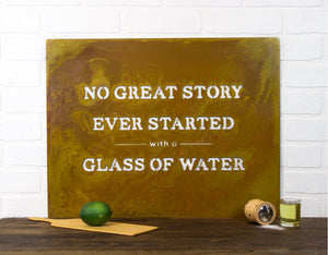 "No Great Story Wall Plaque – Metal sign with humorous quote ""No great story ever started with a glass of water"" made into a fun, contemporary piece of wall art"