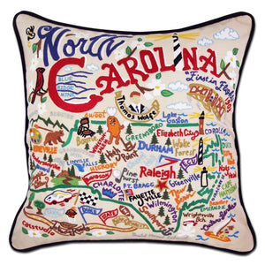 North Carolina Hand-Embroidered Pillow -  What a beautiful state! This original design celebrates the state of North Carolina—from Cape Fear to Asheville to Duck to Kitty Hawk, where man's first flight took place.