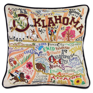 Oklahoma Hand-Embroidered Pillow -  Our favorite musical and this original design celebrates the state of Oklahoma. From Enid to Ardmore and the Arbuckle Mountains to Black Mesa, Oklahoma is more than OK!