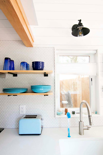 Penny tile and ship lap add a modern farmhouse vibe to the interior of this Portland Oregon tiny house.