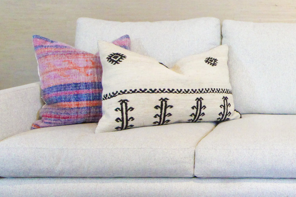 Throw pillows are an inexpensive way to add style to a sofa.