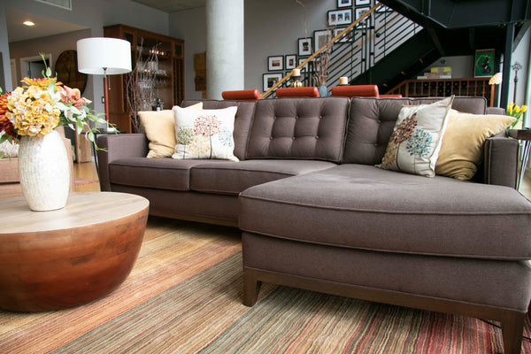 Lawson sofa chaise with buttons and a wooden base trim