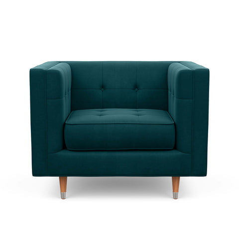 The Gramercy chair, in forest green, is modern with a vintage feel