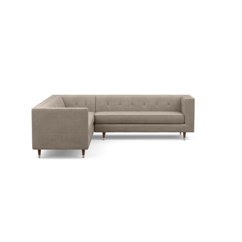 The Gramercy sofa sectional, in taupe, is a modern couch with a vintage feel