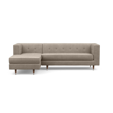 The Gramercy sofa chaise sectional, in taupe, is a modern couch with a vintage feel