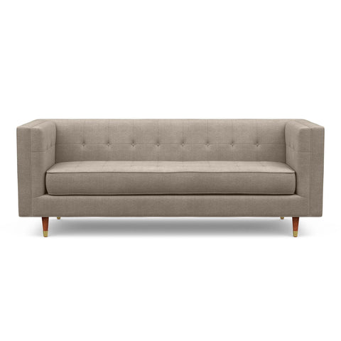 The Gramercy sofa, in sand, is a modern couch with a vintage feel