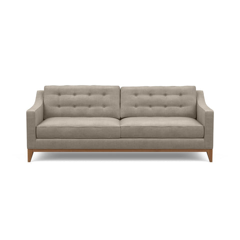 Refined traditional mid-century design is reflected in the Lawson Sofa, pictured here in taupe