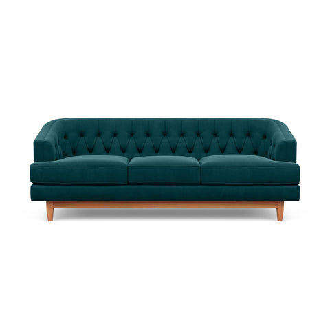 The Taylor Sofa in jade green is Hollywood Regency furniture at its best.