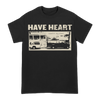 "BHC! The Have Heart ""Ramblin"" tee comes in black with tan ink. It features the band's name at the top with a photograph of a van and trailer and the words, ""ramblin' boy blues."" No back print. This design is printed on Gildan."