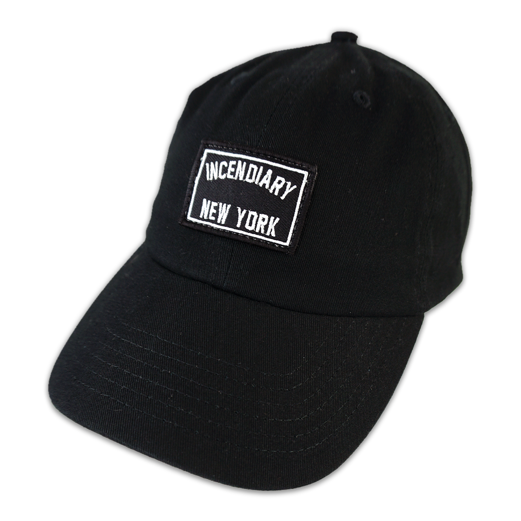 "Grab this 100% cotton snapback cap, featuring an embroidered patch with ""Incendiary New York"" in white on black. Available in Maroon, Black, and Navy.  Cap features 100% bio-washed chino twill; unstructured, six-panel, low-profile construction; pre-curved visor; self-fabric tri-glide buckle closure in antique brass; tearaway label. Size: 6 5/8"" - 7 3/8"""