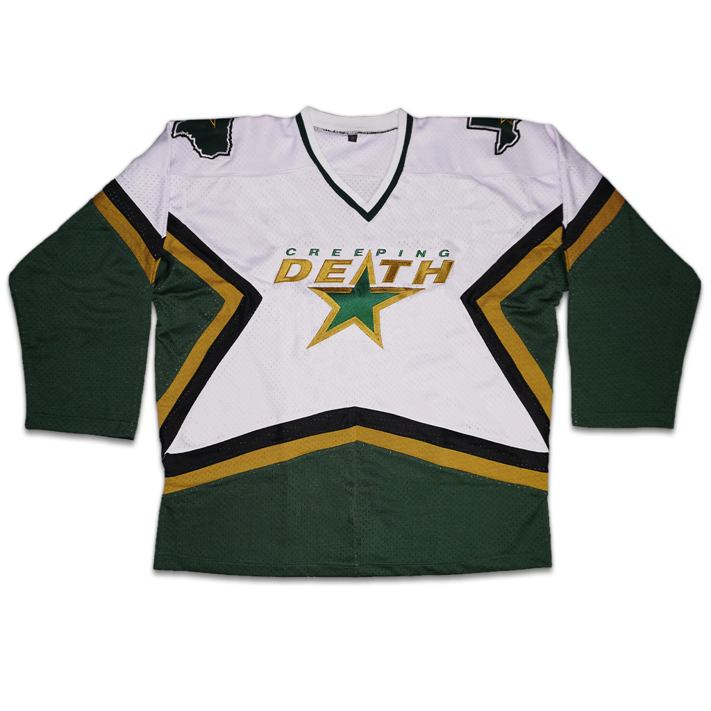 "Creeping Death brings you this fully custom hockey jersey with embroidery and appliqué on the front, back, and both shoulders.  Green and gold on a green, white, gold, and black jersey with the ""Creeping Death"" star design on the front, outline of the state of Texas on both shoulders, and ""World Decay"" on the back above the number 0."