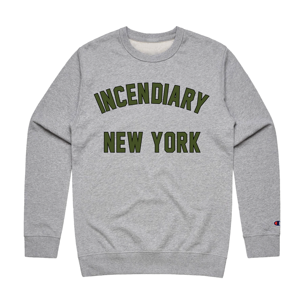 "Incendiary ""New York Arch"" design, printed on the front of a grey Champion brand double dry eco crewneck sweatshirt.  Sweatshirt features include 9oz., 50/50 cotton/polyester blend, made with up to 5% recycled polyester from plastic bottles; durable coverstitching throughout; heavy ribbed knit waistband and cuffs; set-in sleeves; and ""C"" logo on left sleeve."