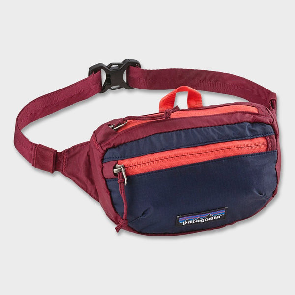 product: Patagonia Lightweight Travel Mini Hip Pack Patchwork: Arrow Red w/ Classic Navy